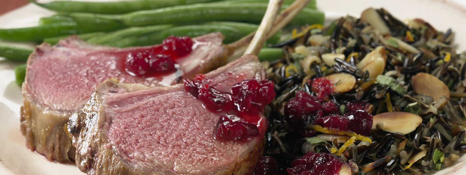 Big Green Egg Cranberry-Marinated Rack of Lamb with Almond Wild Rice