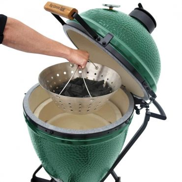 Stainless Steel Fire Bowl with Lump Charcaol being lowered into Large EGG