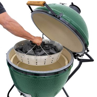 Stainless Steel Fire Bowl with Lump Charcaol being lowered into XL Big Green EGG