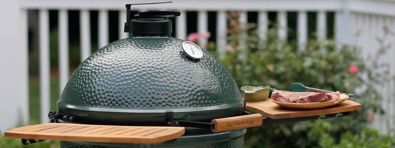 XL EGG with EGGmates and steak getting ready to be grilled in a beautiful backyard setting.